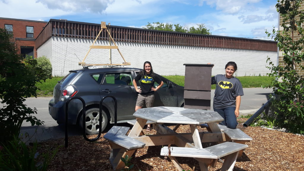 Delaina Arnold and Tianna Burke in front of the bat mobile and a bat house. Credit D Bywater